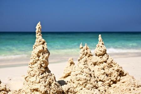 beach toys: Sand castle on the sand of a beach