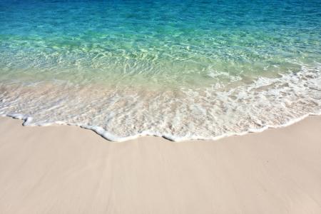 caribbean sea: Wave of the sea on the sand beach