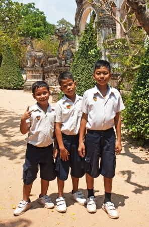 SIEM REAP, CAMBODIA MARCH 31: Three students posing in front of the temple of Wat Bo in Siem Reap, Cambodia. The constitution of Cambodia promulgates free compulsory education for nine years. Stock Photo - 19885977