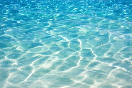 Stralende blauwe water rimpel achtergrond Stockfoto