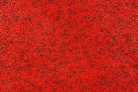 graining: Red book background textured with deep graining patterns