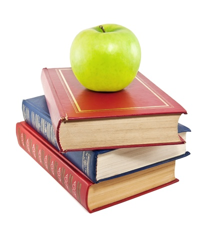 red book: A green apple on top of a stack of old books