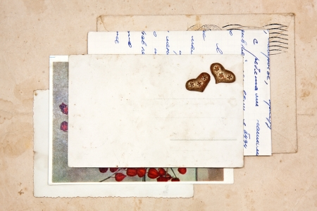 old letters, empty post cards and two hearts, vintage background photo