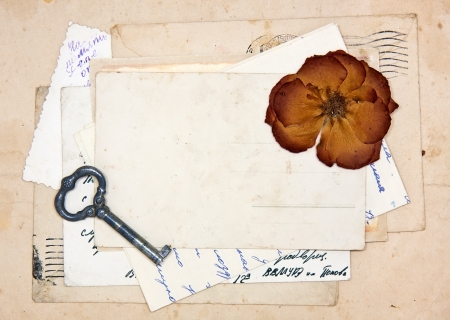 old letters, empty post cards and dried rose, vintage background photo