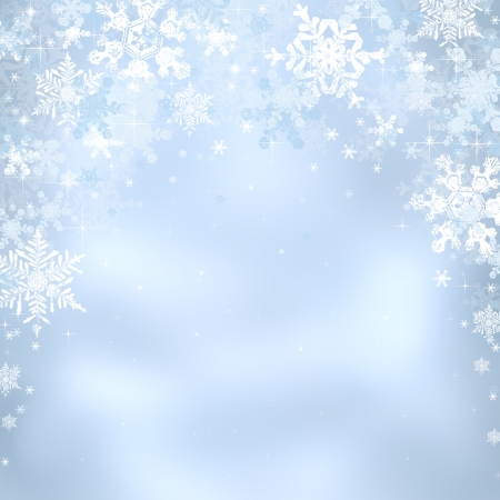 Decorative blue christmas background with bokeh lights and snowflakes