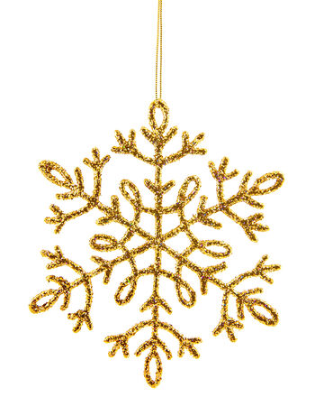 Gold shiny snowflake isolated on a white background Stock Photo - 23240852