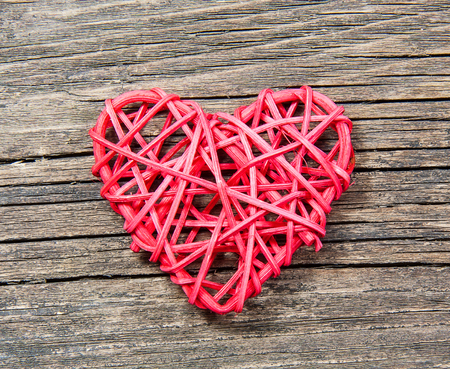 Red heart on wooden background photo