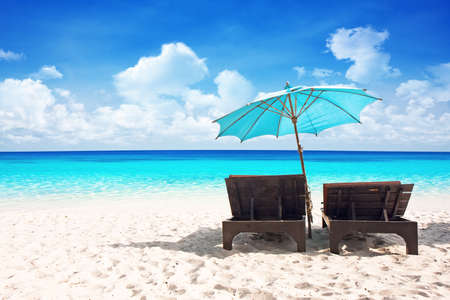 outdoor chair: Beach chairs with umbrella and beautiful sand beach