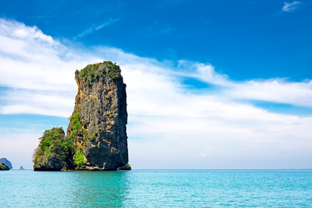 tropical beach with sea and limestone rock, Krabi, Thailand photo
