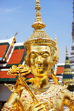 Golden statue at Wat Phra Kaew, Temple of the Emerald Buddha. The Grand Palace Bangkok Thailand  photo