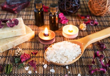 Spa with natural bath salt, candles, soap, towels and petals 스톡 콘텐츠