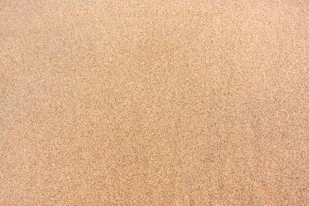 Textured wet sand background 스톡 콘텐츠