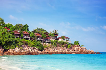 phangan: bungalow on the mountain over water with coconut trees