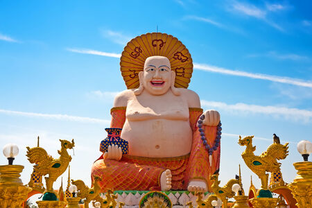 Big Laughing Buddha Statue in Wat Plai Laem, Koh Samui, Thailand photo