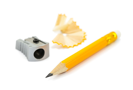 pencil, sharpener, shavings isolated on a white background photo
