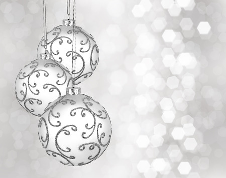 silver balls: Three beautiful christmas balls on a silver background
