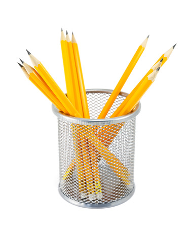 Yellow pencils in metal pot on a white background photo