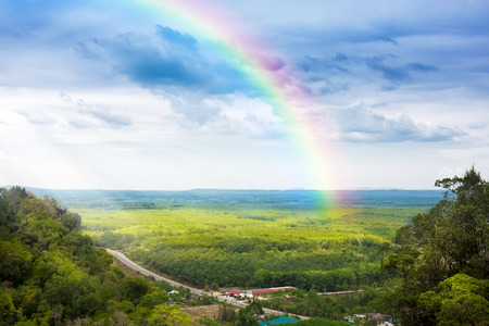rainbow scene: beautiful landscape with cloudy blue sky and rainbow