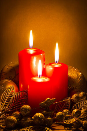 Christmas decoration with candles over dark background photo