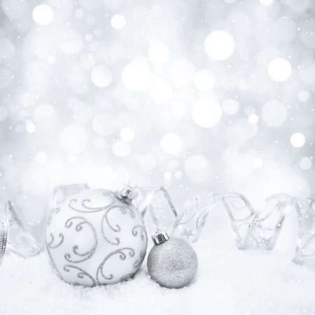 silver ribbon: Decorative christmas background with bokeh lights and snowflakes Stock Photo