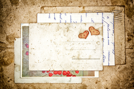 old letters and empty post card, vintage background photo