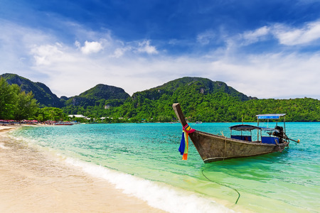 Long tail boat on tropical beach, Krabi, Thailand Stock Photo