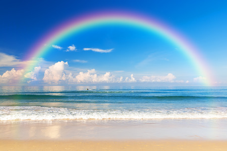 rainbow scene: Beautiful sea with a rainbow in the sky. Karon beach, Phuket, Thailand. Asia Stock Photo