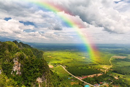 rainbow scene: Beautiful landscape with a rainbow in the sky
