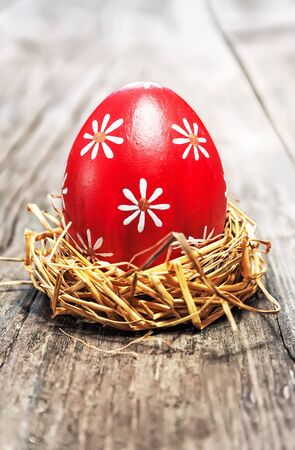 Red Easter egg on wooden background photo