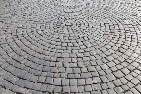 Vintage stone street road pavement texture Standard-Bild
