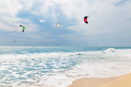 kiting: Kite surfing in waves, Mui Ne Beach, Vietnam, Asia Stock Photo