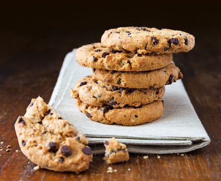 chocolate chips: Chocolate chip cookies on old wooden table