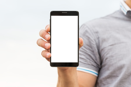 blank tablet: Young man showing a mobile phone application, close up
