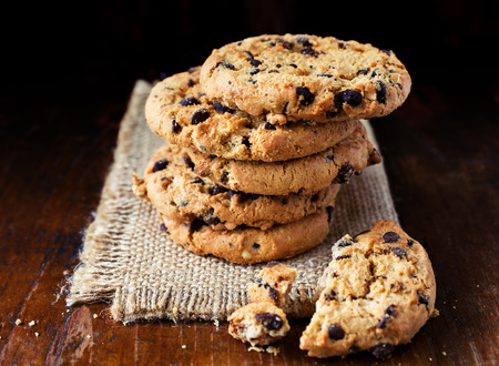 Chocolate chip cookies on old wooden table