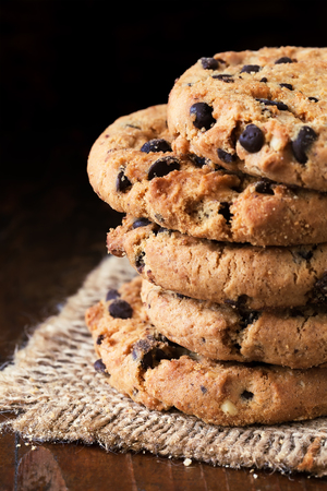 chocolate cookies: Chocolate chip cookies on old wooden table