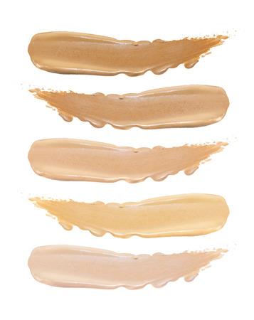 Set of foundation swatches isolated on white background