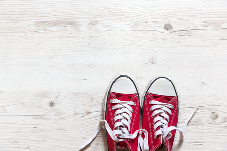 wooden shoes: Old red shoes on wooden background