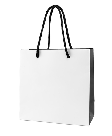White and black paper shopping bag isolated Фото со стока