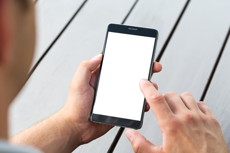 blank tablet: Man holding smart mobile phone on wooden table background