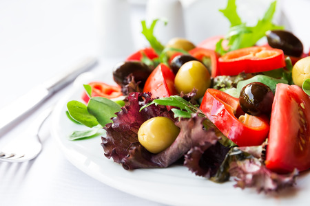 olive green: Mediterranean salad with tomatoes, olives and peppers