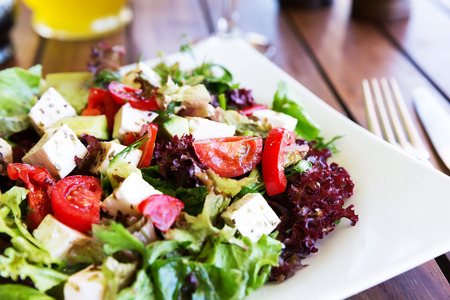 Greek Mediterranean salad with feta cheese, tomatoes and peppers. Mediterranean salad. Mediterranean cuisine. Greek cuisine. 스톡 콘텐츠