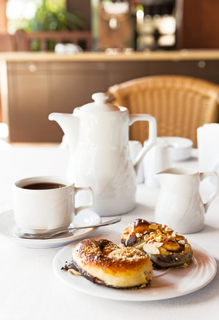 tea house: Breakfast with cake and coffee in the kitchen Stock Photo
