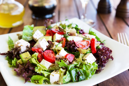 mediterranean cuisine: Greek Mediterranean salad with feta cheese, tomatoes and peppers. Mediterranean salad. Mediterranean cuisine. Greek cuisine. Stock Photo