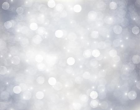 Fondo decorativo de la Navidad con las luces de bokeh y los copos de nieve