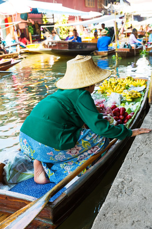 ferrying: Traditional floating market in Damnoen Saduak near Bangkok. Thailand