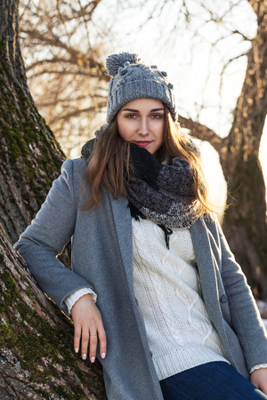 winter fashion: Beautiful girl enjoying her time outside in park Stock Photo