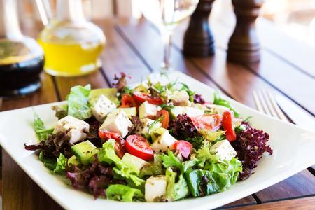 greek cuisine: Greek Mediterranean salad with feta cheese, tomatoes and peppers. Mediterranean salad. Mediterranean cuisine. Greek cuisine. Stock Photo