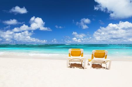 cana: Beach chairs and beautiful sand beach in Punta Cana, Dominican Republic