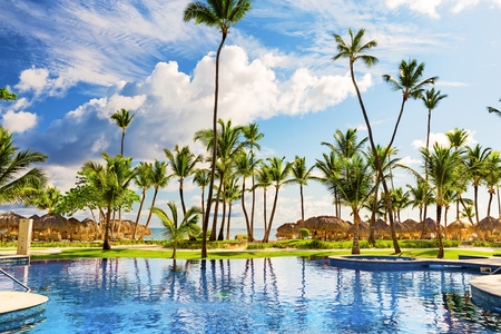 cana: Tropical beach resort with umbrellas and lounge chairs in Punta Cana, Dominican Republic Stock Photo