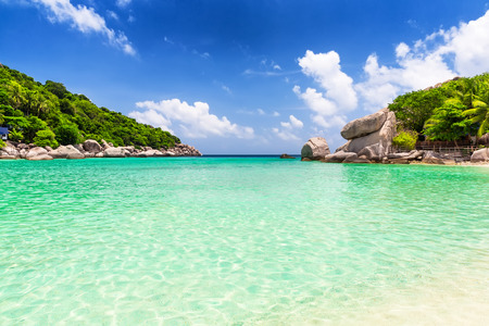 Blue sky and beautifu sandl beach in Koh Tao, Thailand. Vacation holidays background wallpaper. View of nice tropical beach.Travel summer holiday background concept.
